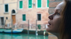 Woman with sad look outdoor in Venice Stock Footage