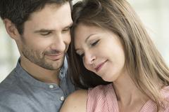 Couple embracing, portrait - stock photo