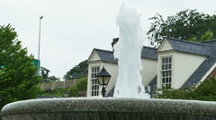 Stock Video Footage of 3919 Water Fountain with Colonial Architecture Behind in Slow Motion