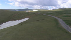 AERIAL United States-Climbing Over Beartooth Pass To State Border Stock Footage