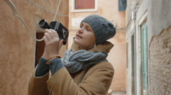 Female tourist using retro video camera outdoor Stock Footage