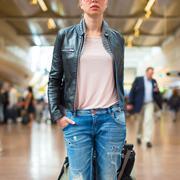 Female traveller walking airport terminal. - stock photo