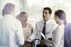 Stock Photo of Team members receive direction from supervisor
