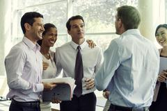 Business team members having lighthearted moment together - stock photo
