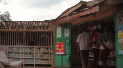 People outside a grocery shop in rural town of Maralal, Kenya, Africa Stock Footage