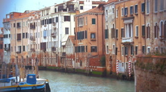 Venice cityscape with old style houses and still canal Stock Footage