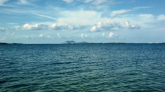 Stock Video Footage of Timelapse of blue sea and sparse clouds in the distance