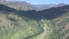 Stock Video Footage of AERIAL United States-Camper Van On Route 20 By Shoshone River