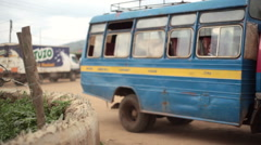 Bus arriving at Maralal town street, Samburu, Kenya, Africa Stock Footage