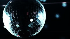 Discoball mirrorball spinning reflecting light into a club venue - stock footage