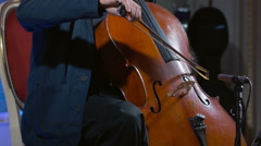 Close-up of a cello player bowing his instrument Stock Footage