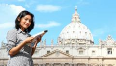 Woman studying a city map and smile to camera Stock Footage