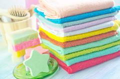 Assortment of soap and towels Stock Photos