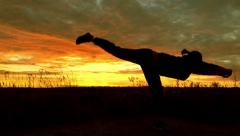 Sporty girl doing exercises at sunset Stock Footage