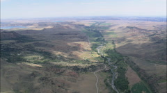 AERIAL United States-Leaving The Absaroka Range Down Wood River Valley Stock Footage