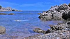 Azure Blue Granite Rock Sea Coast Bay Baia Sardinia Italy - 29,97FPS NTSC Stock Footage