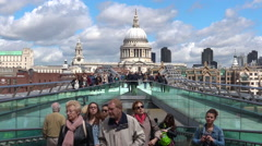 St Pauls Cathedral as view from Millennium Bridge London UK Stock Footage