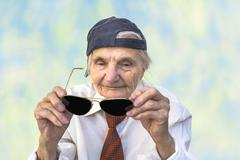 Stock Photo of Funny elderly woman with eyeglasses.