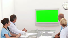 Stock Video Footage of Medical team looking at green screen and applauding