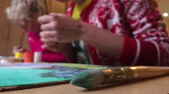 Two girls paint in the art school Stock Footage