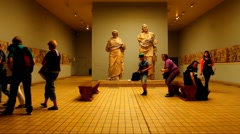 Unidentified tourists at one of the halls of The British Museum Stock Footage