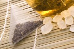 White tea, nylon tea-bag and sugar Stock Photos