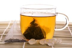 White tea, nylon tea-bag and sugar Stock Photos
