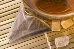 white tea, nylon tea-bag and sugar - stock photo