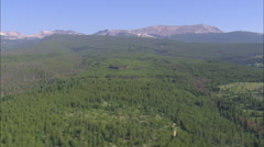 AERIAL United States-Crossing Forest With Anaconda Range In Background Stock Footage