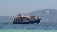 Boat with tourists passing by Stock Footage