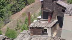 AERIAL United States-Abandoned Mine Buildings On Hillside Stock Footage
