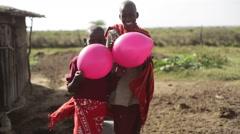 African children with colorful balloons, Samburu, Kenya Stock Footage