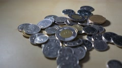 20$ Canadian pile falls onto pile of change Stock Footage