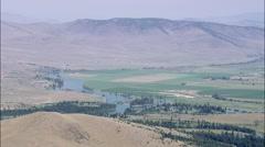 AERIAL United States-Flight Landing On Grass Hilltop Stock Footage