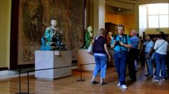 Unidentified tourists at  hall of British Museum with Buddhist sculptures Stock Footage