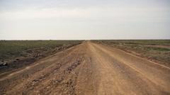 Dirt road to nowhere leads to horizon, Samburu, Kenya, Africa - stock footage