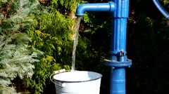 blue water pump and fresh water - stock footage