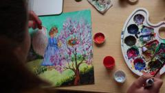 Girl draws picture with acrylic paints Stock Footage