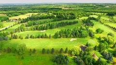 Time Lapse Aerial Flyover, Golf Course, Cloud Shadows Sweeping Across Stock Footage