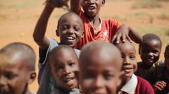 Cute African children smile and play, Samburu, Kenya, Africa Stock Footage