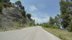 POV of a driving car on a raod in the mountains in Greece in Time Lapse Stock Footage