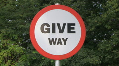 Give Way Yield Traffic Road Sign In England - stock footage