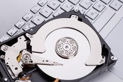 Hard disk HDD over laptop keyboard Stock Photos