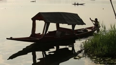 Boat and indian people in Dal lake. Srinagar, Jammu and Kashmir state, India Stock Footage