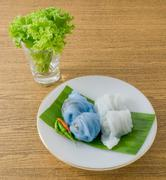 Thai Traditional Dessert, Plate of Steamed Rice Skin Dumplings Made From Glut - stock photo