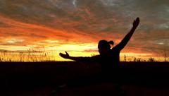 A girl who knows karate. Doing rifts from foot to foot at sunset Stock Footage