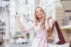 Girl with packages after shopping - stock photo