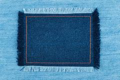 Frame of  denim  with fringe with place for your text - stock photo