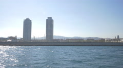 The seashore of Barcelona with Mapfre Tower and Hotel Arts Stock Footage