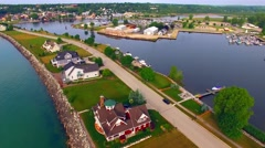 Aerial View of Luxury Homes Lining Scenic Waterfront Peninsula - stock footage